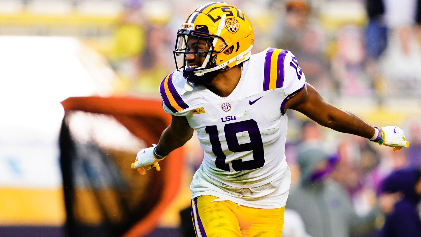 BATON ROUGE, LA - DECEMBER 19: Jabril Cox #19 of the LSU Tigers reacts after a play against the Ole Miss Rebels at Tiger Stadium on December 19, 2020 in Baton Rouge, Louisiana.