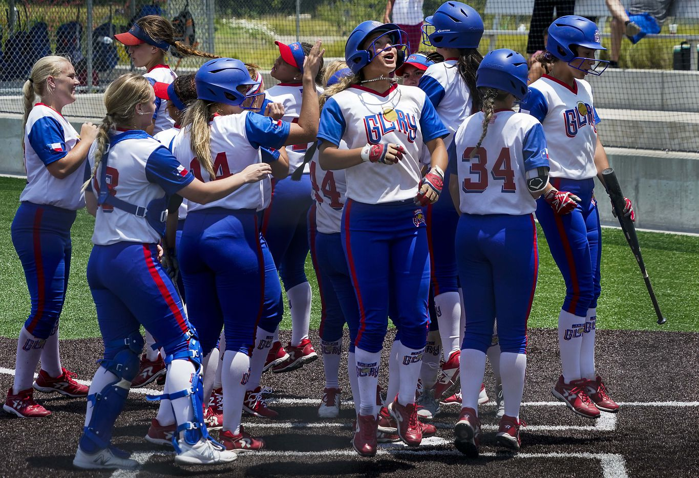 Texas Glory 18U players, including shortstop Jayda Coleman (facing at center) celebrate after third baseman Trinity Cannon (44) hit a home run against the American Freedom Gold Coleman 18U during a Triple Crown Texas State Tournament game at Spirit Park on Monday, June 15, 2020, in Allen, Texas. (Smiley N. Pool/The Dallas Morning News)
