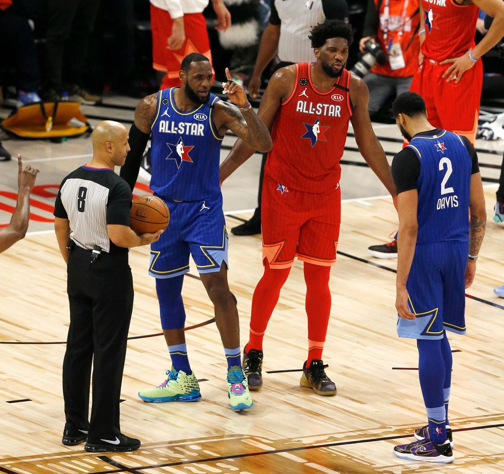 Team Giannis's Joel Embiid (24) talks to Team LeBron's Anthony Davis (2) next to LeBron James before he shoots the game winning free throw during the second half of play in the NBA All-Star 2020 game at United Center in Chicago on Sunday, February 16, 2020. Team LeBron defeated Team Giannis 157-155. (Vernon Bryant/The Dallas Morning News)
