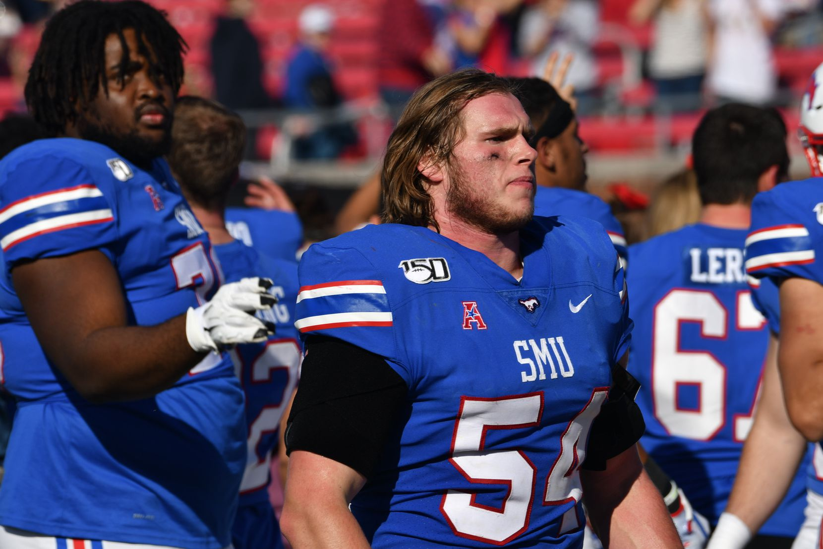 Gerrit Choate looks on during an SMU football game.