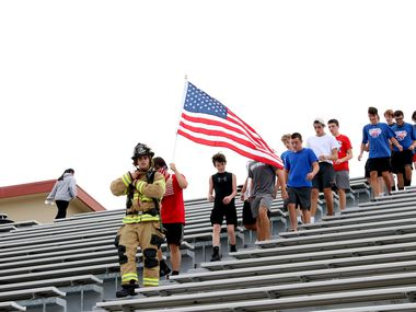 Grapevine High School's wrestling team paid tribute to 9/11 first responders last year on Sept. 11, 2020 at Mustang-Panther Stadium in Grapevine. Members of the Grapevine Fire Department and Grapevine Police Department joined the students in the tribute.
