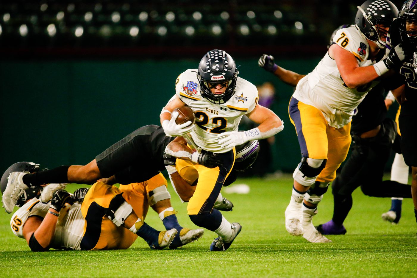 Highland Park's Brooks Bond (22) runs the ball in the second half of a Class 5A Division I area-round playoff game against Frisco Independence at Globe Life Park in Arlington on Thursday, Dec. 17, 2020. Highland Park won 42-20. (Juan Figueroa/ The Dallas Morning News)