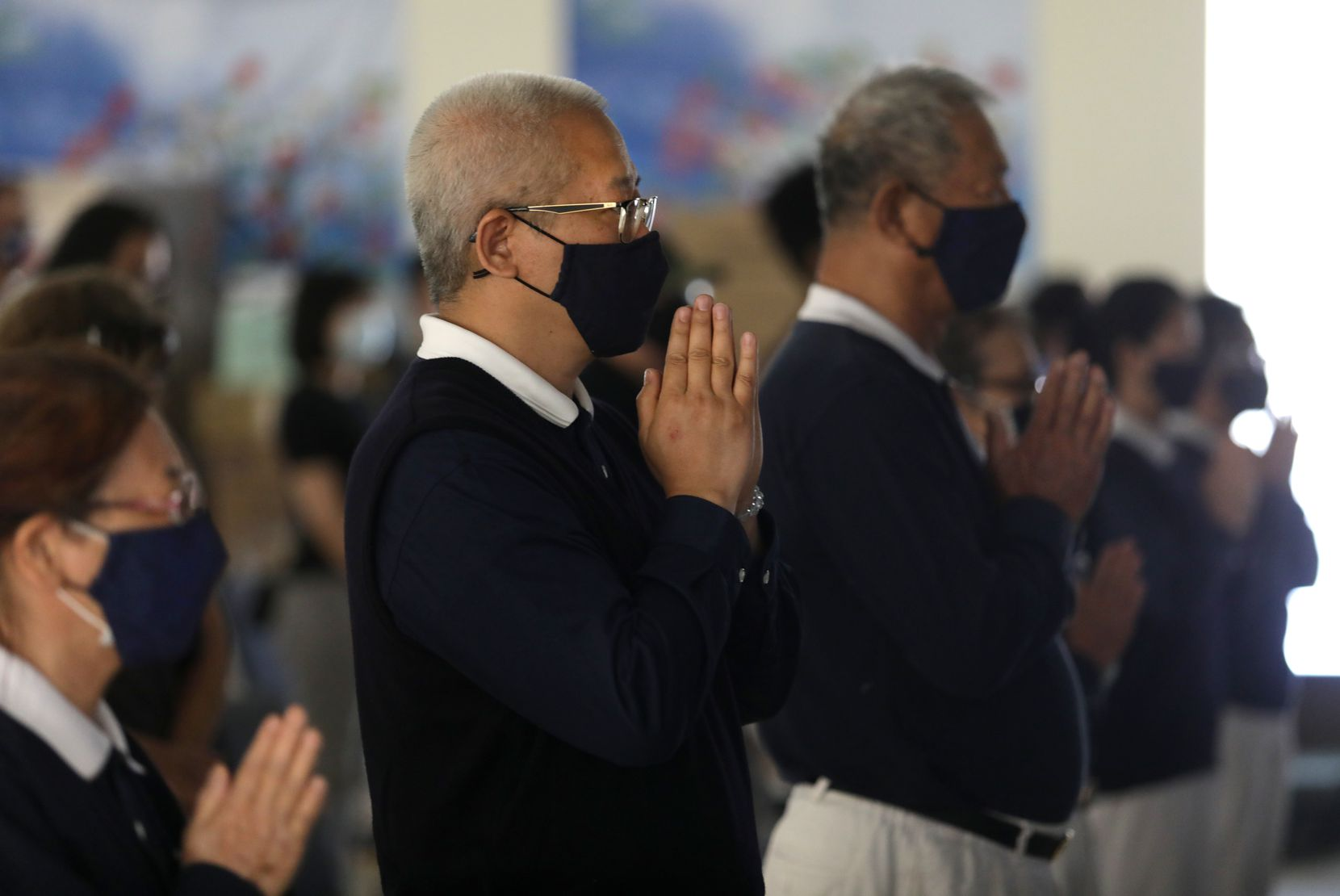 Members of the Tzu Chi foundation say a prayer at the Tzu Chi foundation in Richardson, TX, on Apr. 25, 2021. (Jason Janik/Special Contributor)