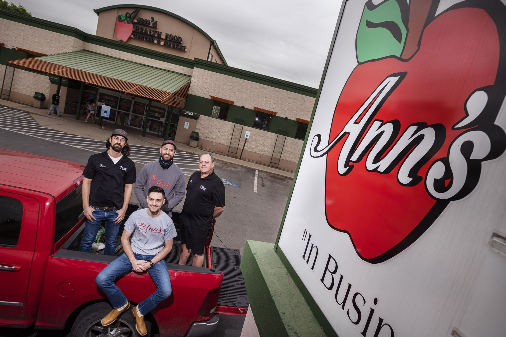 From left: The Munchrath family, brothers and general managers Ryan Munchrath, Landon Munchrath, sitting, Micah Munchrath, center, and their father, owner Matt Manchrath outside Ann's Health Food Store at South Zang Boulevard in Dallas.