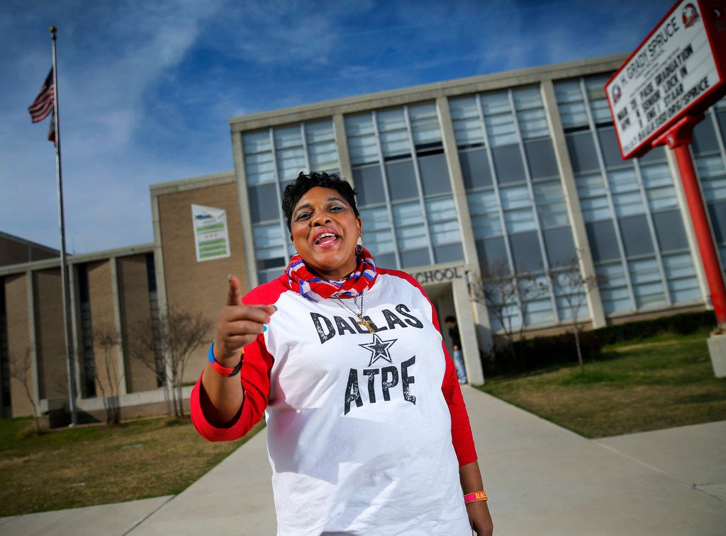 """Teachers aide Rachel Melancon who is known for her spirited """"Spruce It Up!' encouragement of students, poses for a photo outside H. Grady Spruce High School in Dallas where she is a teachers assistant, Friday, March 22, 2019. Melancon, who is a local Association of Texas Professional Educators board member, is fighting for teachers' aides, cafeteria workers, counselors, and bus drivers' who say they're the lowest paid and they are the last to be included in raises. They would like to have some compensation along with teachers during this legislative session."""
