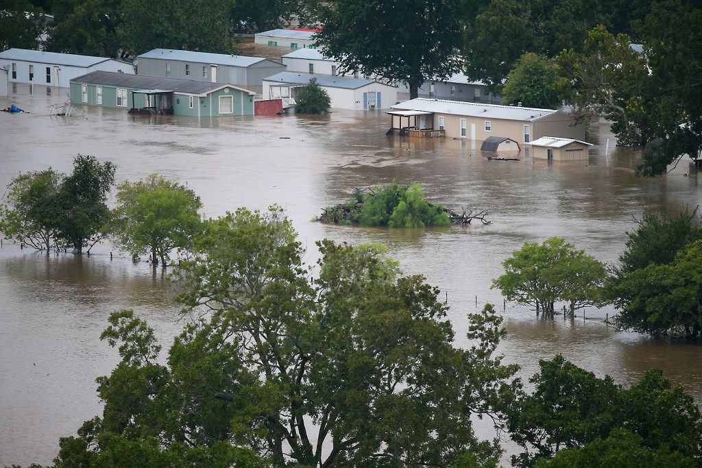 A trailer park is flooded in La Grange, Texas, Monday, Aug. 28, 2017, after floodwaters from Tropical Storm Harvey inundated the area. Floodwaters reached the rooflines of single-story homes Monday and people could be heard pleading for help from inside as Harvey poured rain on the Houston area for a fourth consecutive day after a chaotic weekend of rising water and rescues.