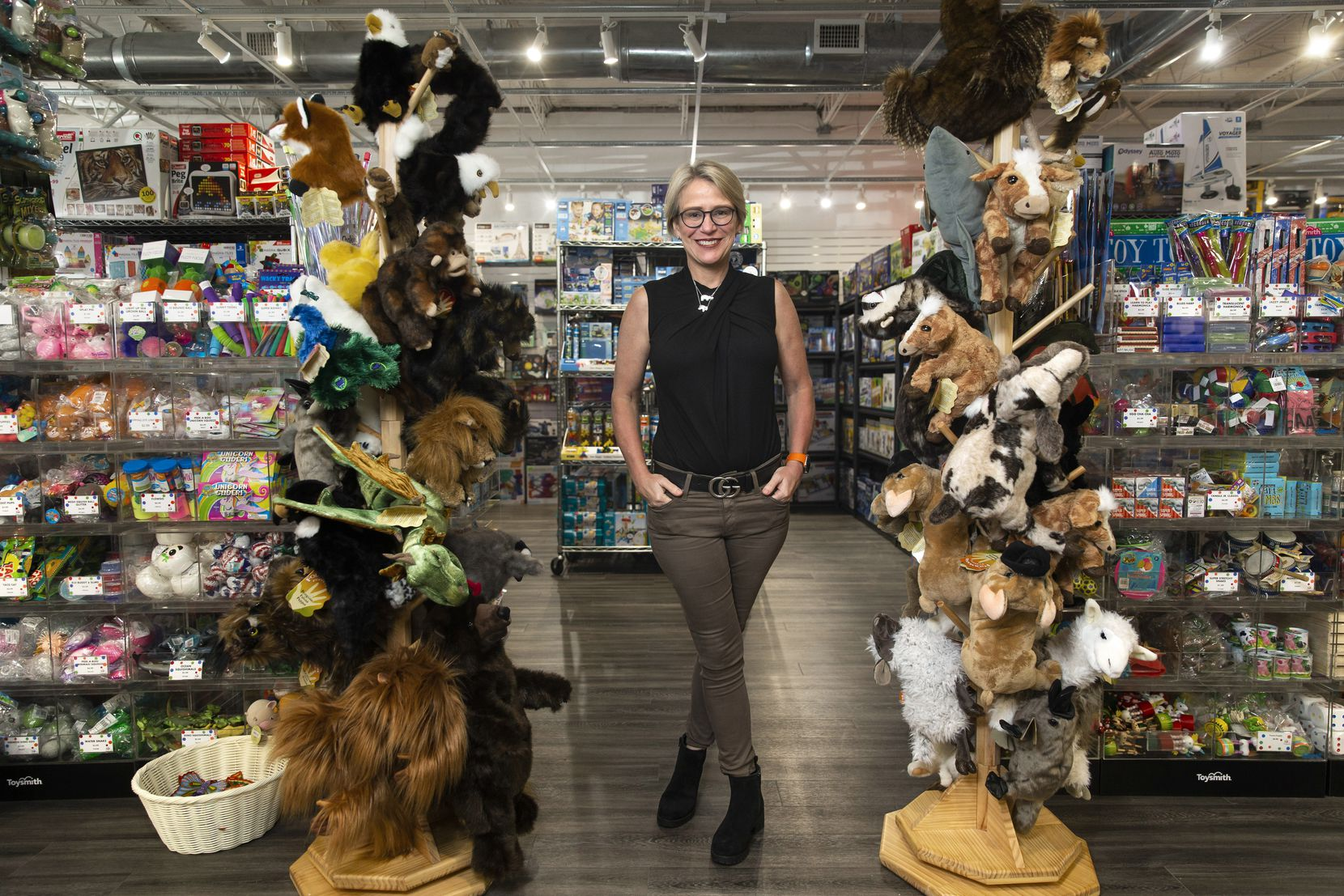 Owner Candace Williams poses for a portrait at The Toy Maven. The retailer just moved back into her original location after extensive repairs.