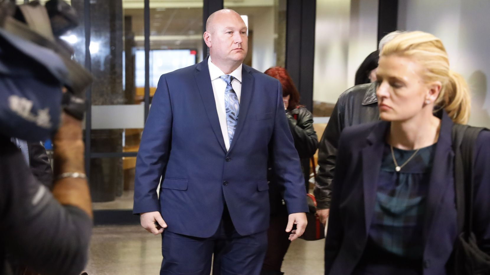 Former Dallas police officer Christopher Hess (center) leaves the Frank Crowley Courts Building in Dallas with his attorneys, Tuesday, February 11, 2020. The jury was in deliberation after closing arguments the afternoon. He's accused of the 2017 fatal shooting of 21-year-old Genevive Dawes. (Tom Fox/The Dallas Morning News)