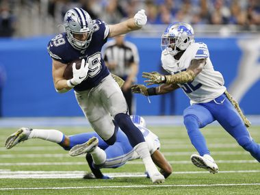 Dallas Cowboys tight end Blake Jarwin (89) runs up the field after the catch as Detroit Lions strong safety Tavon Wilson (32) attempts to tackle him during the first half of play at Ford Field in Detroit, on Sunday, November 17, 2019.