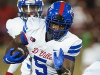 Duncanville running back Malachi Medlock (5) finds a hole in the line during the second half of a high school football game against Mater Dei on Friday, Aug. 27, 2021, in Duncanville.
