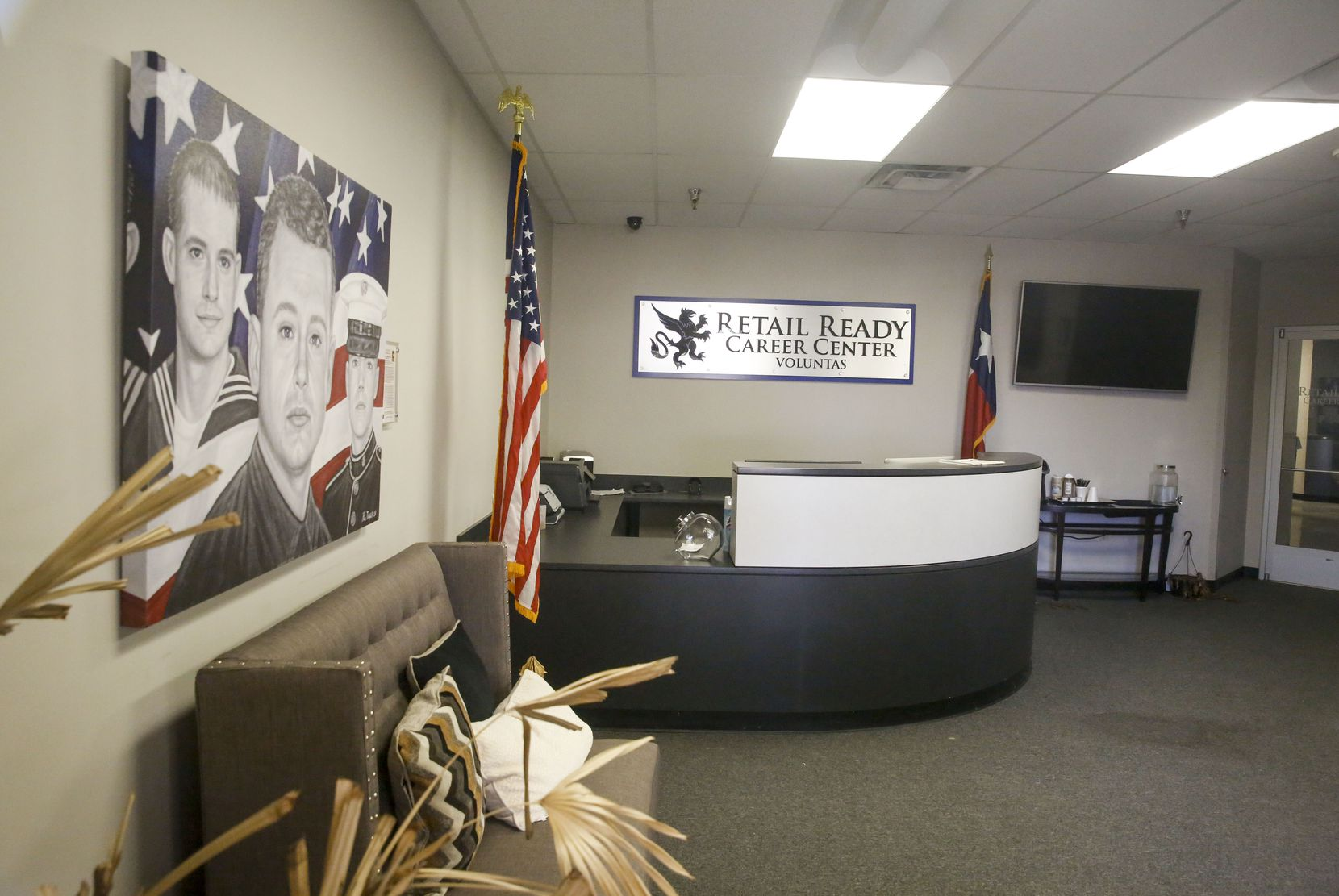 The lobby of the Retail Ready Career Center sits empty and frozen in time in 2019, just as it was when it was closed in 2017 by the federal government as part of a criminal investigation.