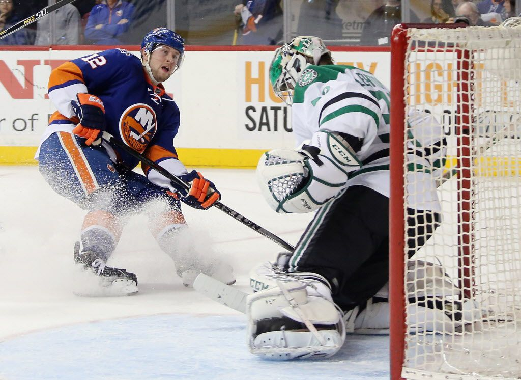 NEW YORK, NY - JANUARY 03: Josh Bailey #12 of the New York Islanders is stopped by Kari Lehtonen #32 of the Dallas Stars during the second period at the Barclays Center on January 3, 2016 in the Brooklyn borough of New York City.  (Photo by Bruce Bennett/Getty Images)