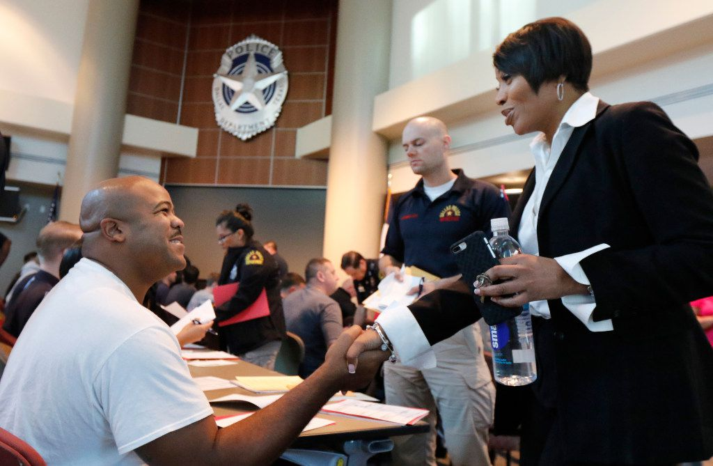 Dallas Police Chief U. Renee Hall, right, greets applicant Antwain Robinson from Arkansas at the Jack Evans Police Headquarters in Dallas on Thursday, September 7, 2017. About eighty candidates are applying to be a Dallas police officer. (David Woo/The Dallas Morning News)