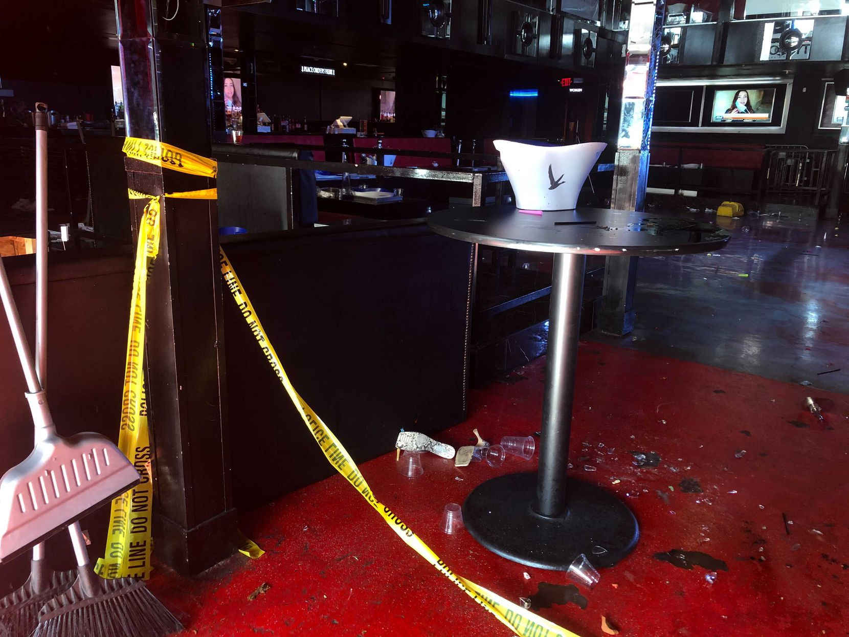 Crime scene tape and debris littered the Pryme Bar in northwest Dallas on Saturday morning. The staff was cleaning up.