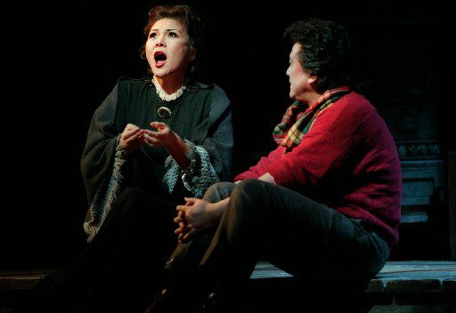 Hei-Kyung Hong as 'Mimi' and Jianyi Zhang as 'Rodolfo' in a scene from the Dallas Opera's 1999  production of La Boheme.