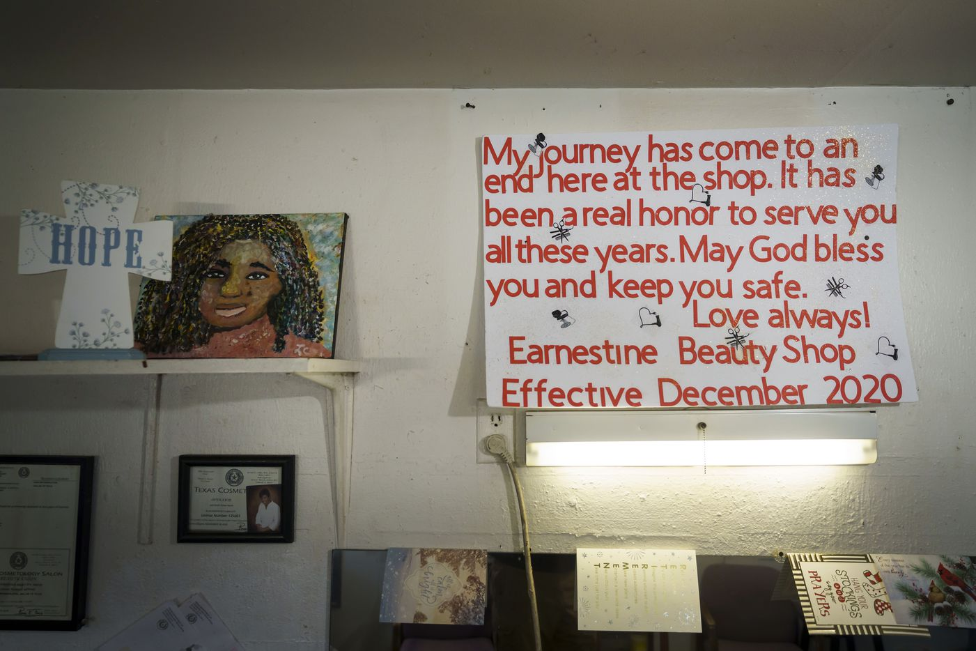 A sign announcing her retirement hangs over the mirrors at Earnestine Tarrant's hair salon.