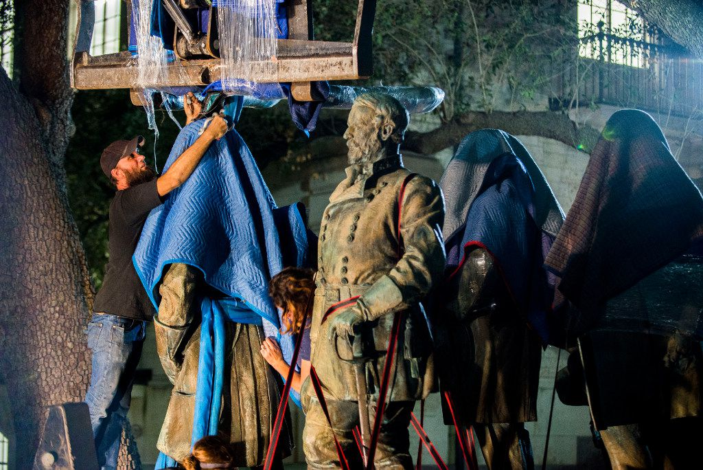 The statues depicting Robert  E. Lee, Albert Sidney Johnston, John Reagan and James Stephen Hogg were removed from the Main Mall at the University of Texas at Austin on Sunday and Monday.