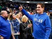 Dallas Mavericks owner Mark Cuban gives a thumbs up to the crowd as he leaves the court after a victory over the Toronto Raptors in an NBA basketball game at American Airlines Center on Saturday, Nov. 16, 2019, in Dallas.