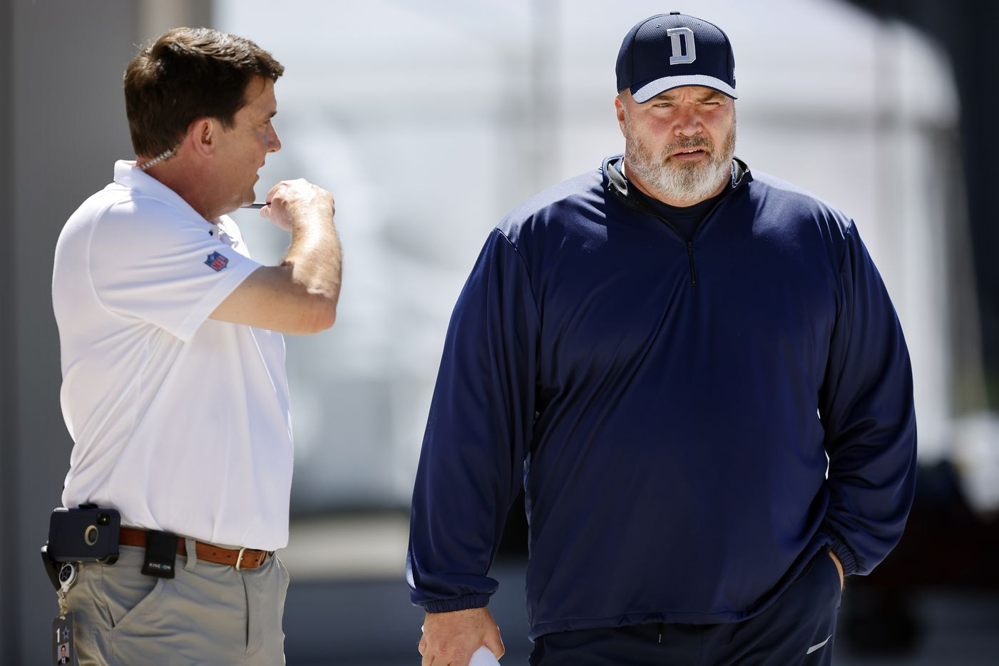 Dallas Cowboys athletic trainer Jim Maurer (left) briefs head coach Mike McCarthy as he arrives for Training Camp practice at The Star in Frisco, Texas, Tuesday, August 24, 2021.(Tom Fox/The Dallas Morning News)