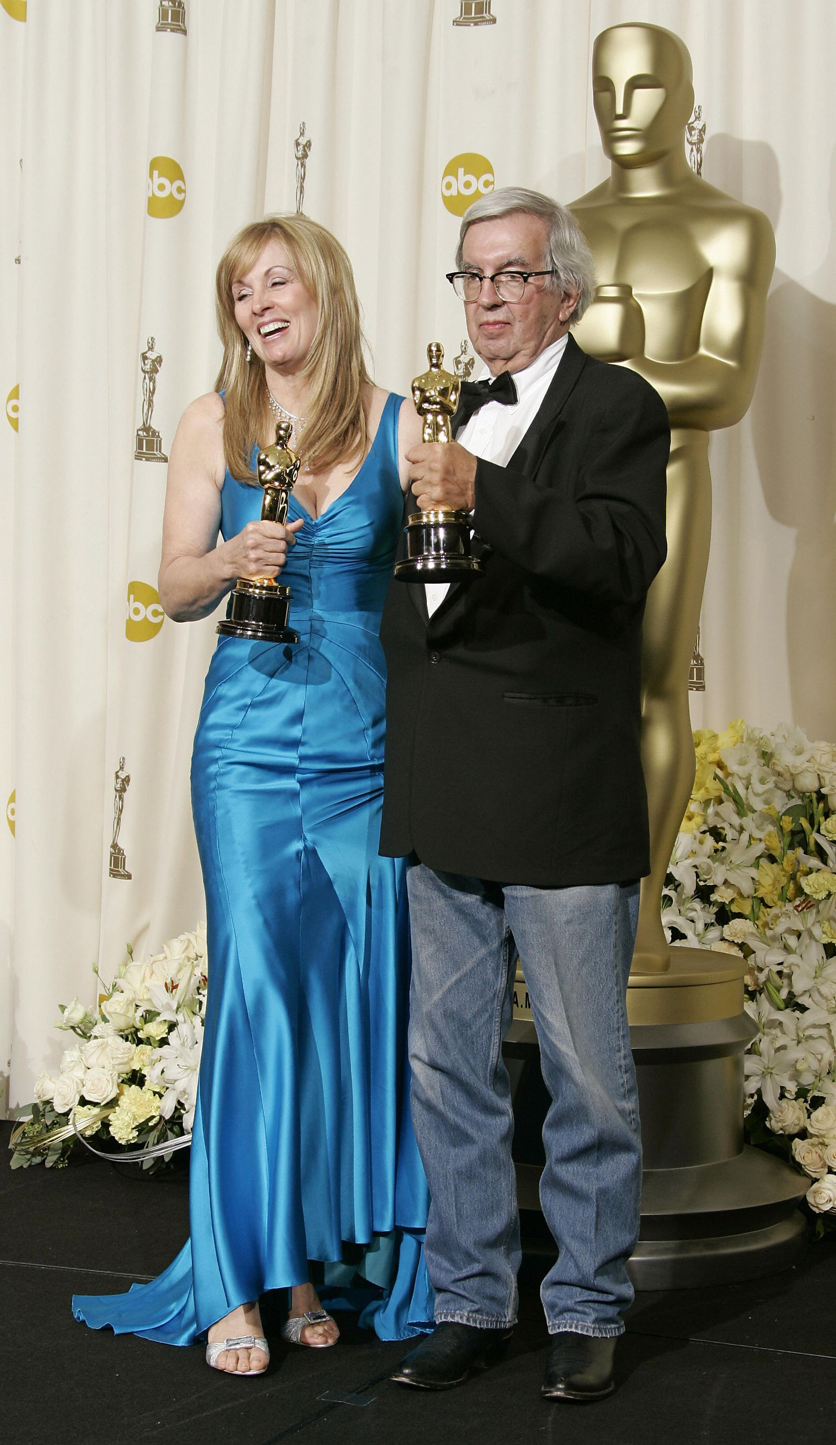"Writers Larry McMurtry and Diana Ossana, shown in 2006 with their Oscars for Best Adapted Screenplay for ""Brokeback Mountain"", during the 78th Academy Awards at the Kodak Theater in Hollywood, California."