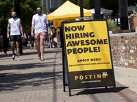 A now hiring sign outside of Position in Deep Ellum on Saturday, May 15, 2021, in Dallas.