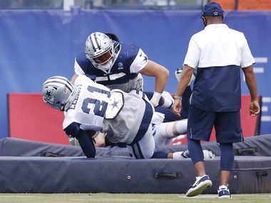 Cowboys linebacker Leighton Vander Esch (55) tackles running back Ezekiel Elliott (21) in a drill at training camp at The Star in Frisco on Thursday, Sept. 3, 2020.