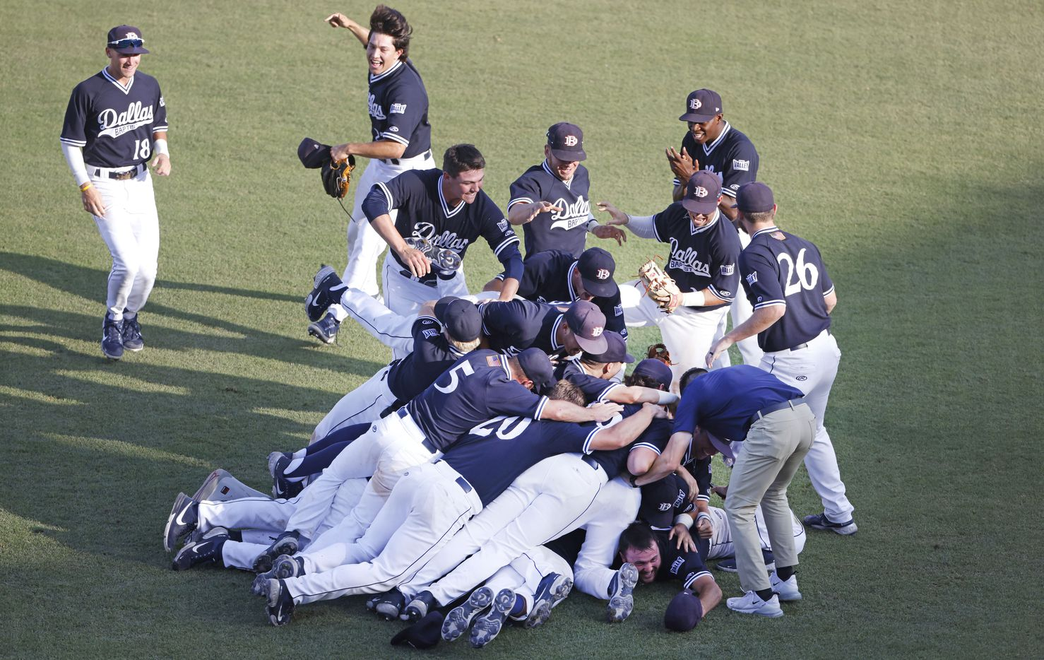Dallas Baptist celebrates their 8-5 win over Oregon St. following the NCAA Division I Baseball Regional Championship game in Fort Worth, Texas on June 7, 2021. (Ron Jenkins/Special Contributor)