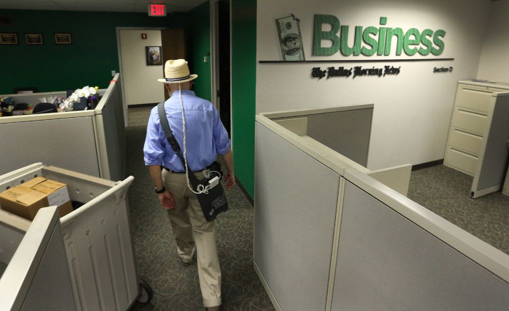 Weiss leaves the business department after visiting with colleagues at The Dallas Morning News.