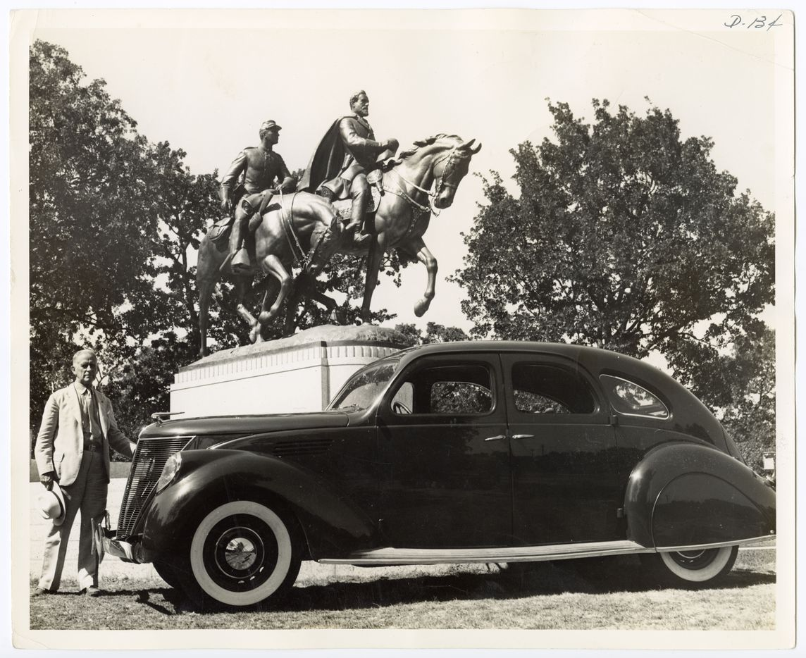 "A. Phimister Proctor, a New York sculptor who produced the equestrian statue of Robert E. Lee, is shown beside his new Lincoln-Zephyr which he has named ""Traveler"" after the Confederate General's horse."