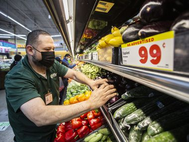 Produce Manager Ruben Flores stocks the shelves at El Rio Grande Latin Market in Mesquite, Friday, March 26, 2021. (Brandon Wade/Special Contributor)