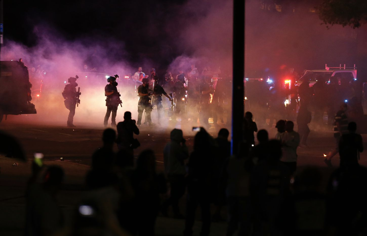 Protesters rally Friday during a demonstration against police brutality near downtown Dallas. The death of George Floyd police custody May 25 in Minneapolis has sparked protests nationwide. The officer who held his knee to Floyd's neck before his death been charged with murder and manslaughter earlier Friday.