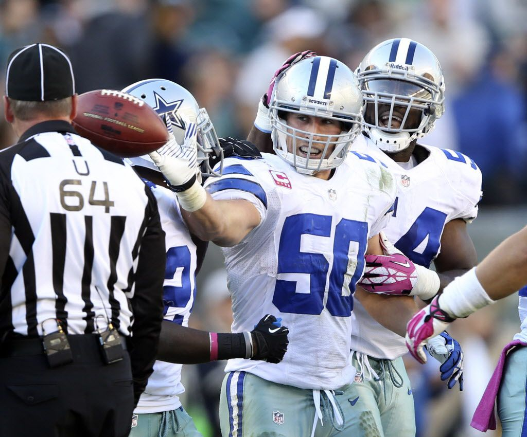 Dallas Cowboys outside linebacker Bruce Carter (54) and Dallas Cowboys cornerback Morris Claiborne (24) congratulate Dallas Cowboys middle linebacker Sean Lee (50) after Lee intercepted a pass from Philadelphia Eagles quarterback Matt Barkley (2) during the second half of play at Lincoln Financial Field in Philadelphia on Sunday, October 20, 2013. Dallas Cowboys defeated the Philadelphia Eagles 17-3.