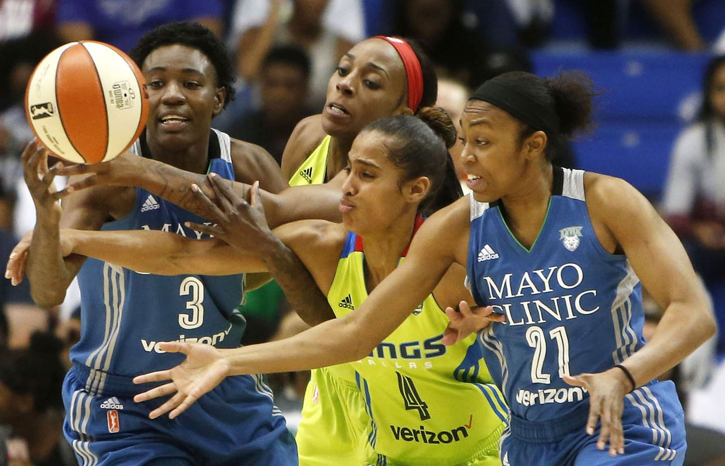 Dallas Wings guard Skylar Diggins (4) and Dallas Wings forward Glory Johnson (25) fight for the ball against Minnesota Lynx forward Natasha Howard (3) and Minnesota Lynx guard Renee Montgomery (21) in the second quarter at College Park Center in Arlington, Texas on Saturday, May 20, 2017.