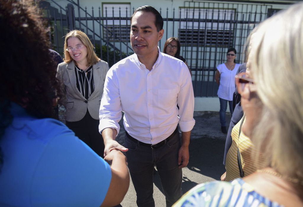 Julian Castro greets residents in Playita, one of the poorest and most affected communities in the aftermath of Hurricane Maria in San Juan, Puerto Rico, on Jan. 14, 2019. The presidential candidate joined dozens of high-profile Latinos in Puerto Rico to talk about mobilizing voters ahead of the 2020 elections and increasing Latino political representation to take on President Donald Trump.