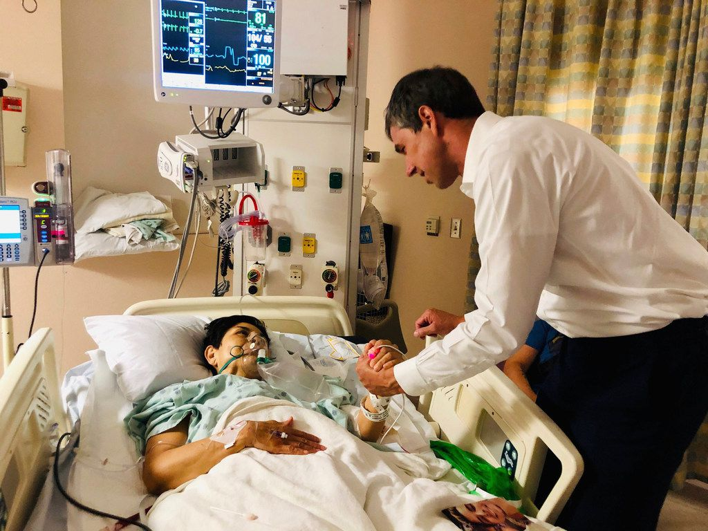In this image from Beto O'Rourke's Facebook page, the presidential candidate and former congressman meets with a survivor at University Medical Center in El Paso on Aug. 4, 2019, the day after a gunman killed 22 people at a local Walmart.