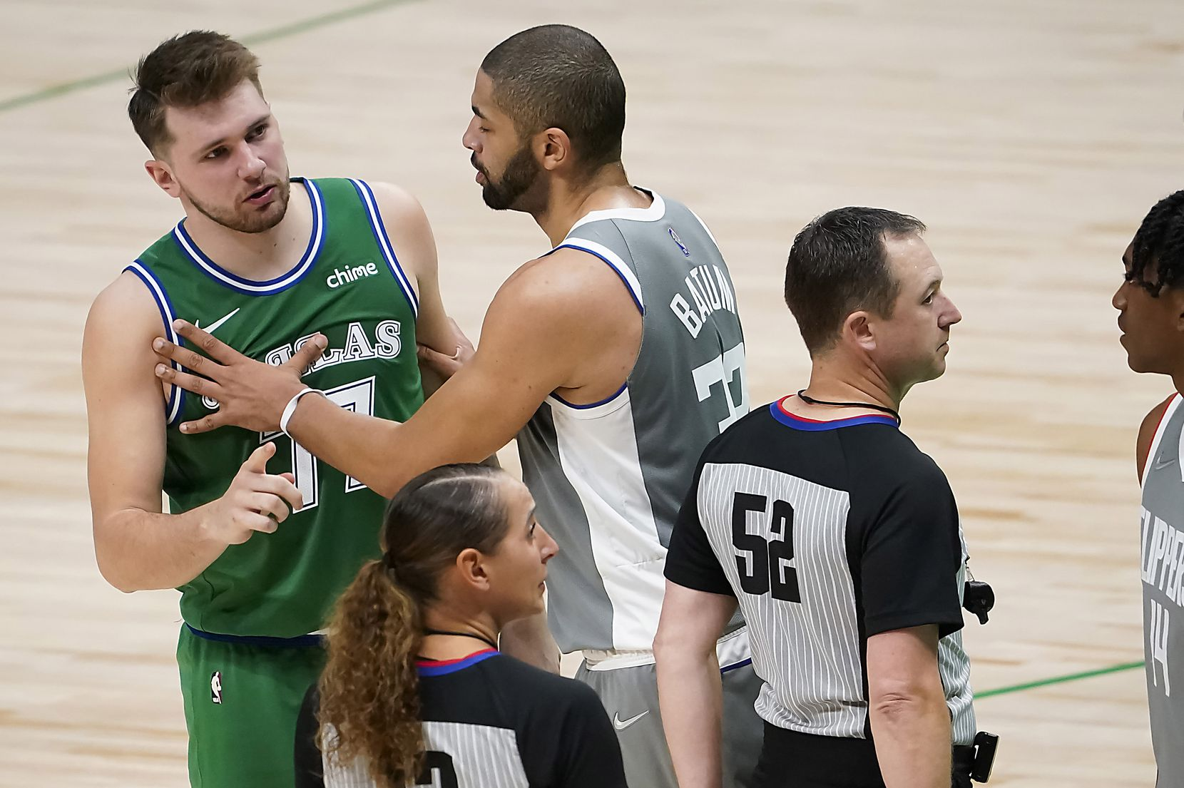 LA Clippers forward Nicolas Batum (33) steps in to separate Dallas Mavericks guard Luka Doncic (77) from Clippers guard Terance Mann (14) as they exchange words during the second half of an NBA basketball game at American Airlines Center on Wednesday, March 17, 2021, in Dallas.