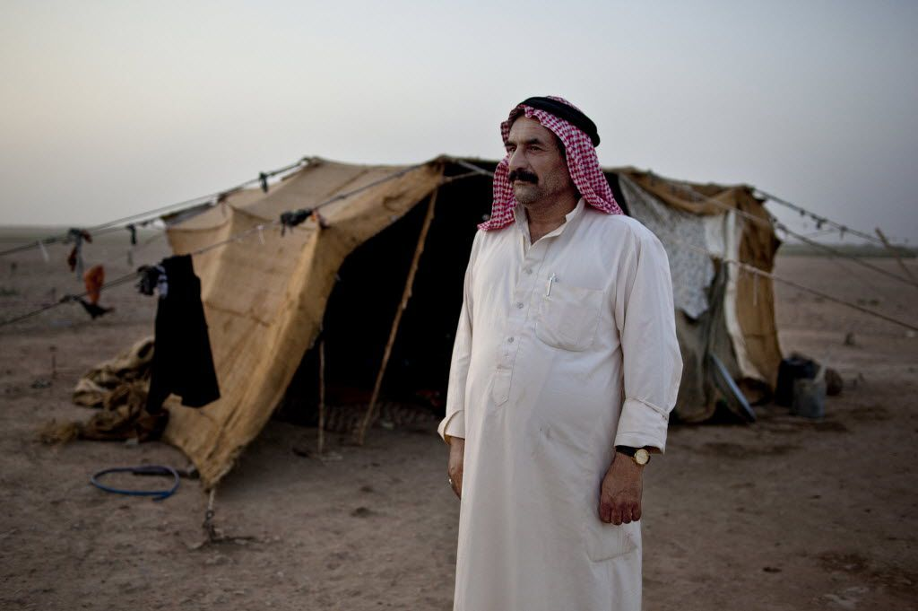 Ahmed Abdullah, a 48-year-old farmer who is living in a burlap and plastic tent here with his wife and 12 children in Al Raqqa, Syria, Sept. 23, 2010. In the Fertile Crescent, including much of neighboring Iraq, ancient irrigation systems have collapsed, underground water sources have run dry and hundreds of villages have been abandoned as it appears to be turning barren, climate scientists say. (Julien Goldstein/The New York Times)