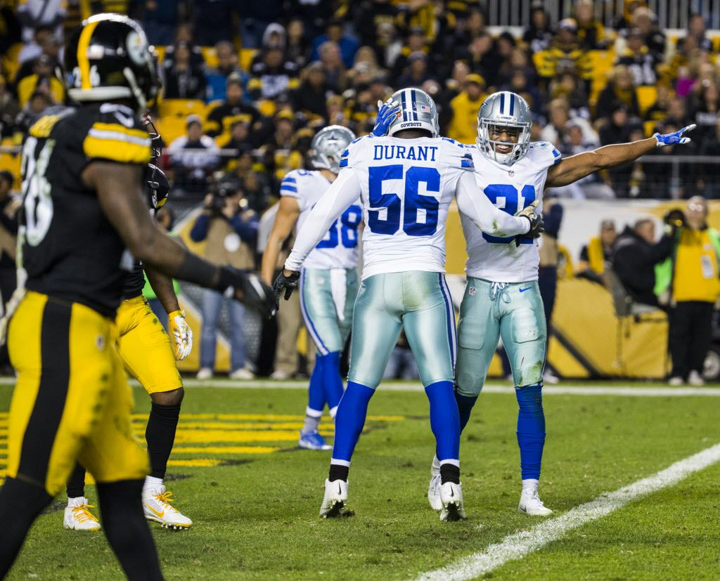 Dallas Cowboys free safety Byron Jones (31) and linebacker Justin Durant (56) celebrate preventing a Pittsburgh Steelers touchdown during the third quarter of their game on Sunday, November 13, 2016 at Heinz Field in Pittsburgh, Pennsylvania.  (Ashley Landis/The Dallas Morning News)