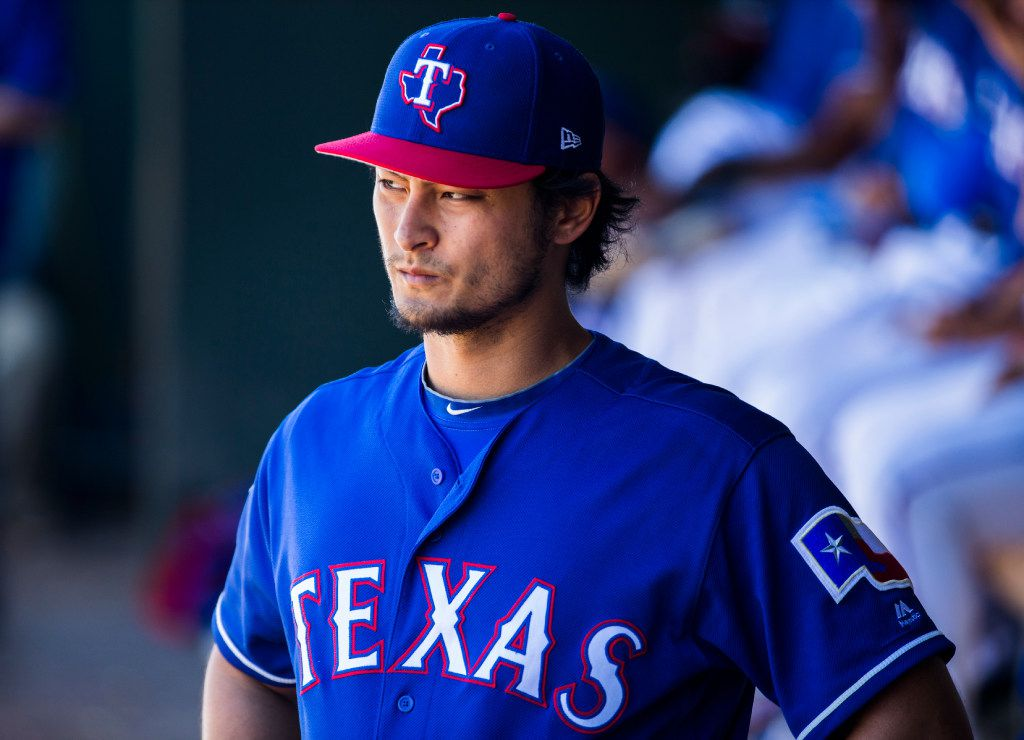 Texas Rangers starting pitcher Yu Darvish (11) watches from the dugout during the fourth inning of a spring training game against the Colorado Rockies on Tuesday, March 7, 2017 at the Ranger's spring training facility in Surprise, Arizona. (Ashley Landis/The Dallas Morning News)