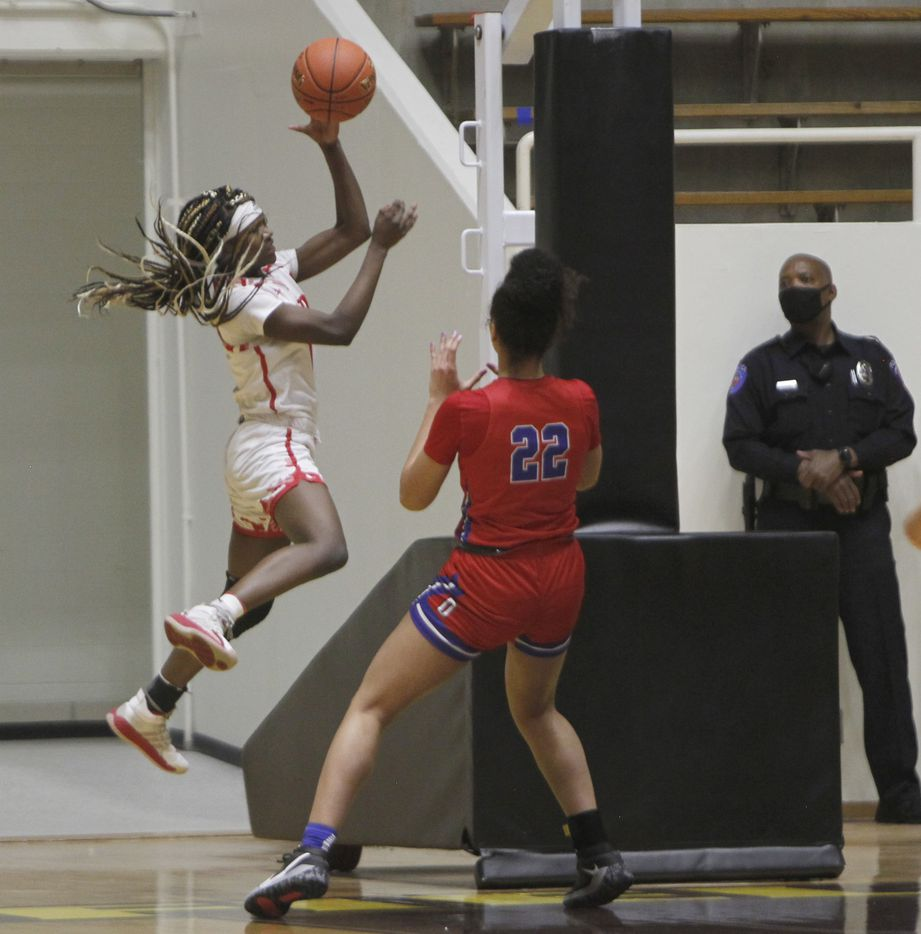 Mesquite Horn guard Camden Harston (4) leaps to save the ball from going out of bounds as Duncanville forward Laila McLeod (22) waits defensively during first half action. The two teams played their Class 6A area-round playoff basketball game at Loos Field House in Addison on February 23, 2021. (Steve Hamm/ Special Contributor)