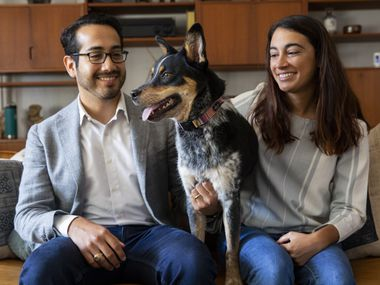 Nic Carmona (left) and Melissa Rodriguez pose with their dog Luna on Friday, June 18, 2021, at their home in Dallas.