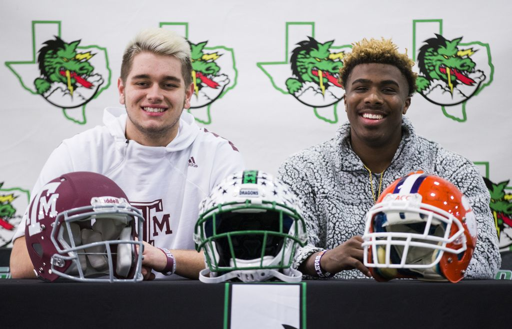Southlake Carroll football players Blake Smith (left) and RJ Mickens pose for a photo after signing national letters of intent on Wednesday, December 18, 2019 at Southlake Carroll Senior High School in Southlake. Smith will attend Texas A&M University and RJ will attend Clemson University. (Ashley Landis/The Dallas Morning News)