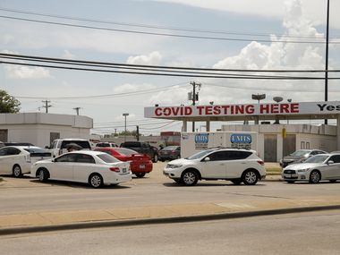 Dozens of people wait in cars for COVID-19 testing at YesNoCovid in Dallas on Aug. 13.