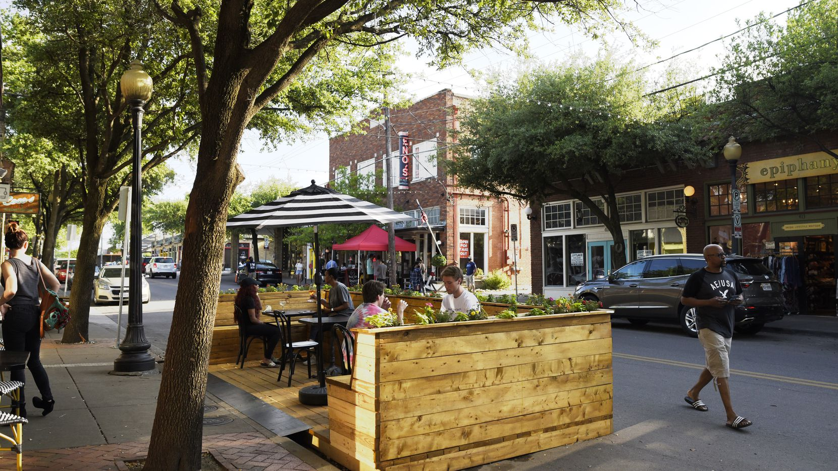 A temporary seating area outside of Revelers Hall on Bishop Avenue in Dallas, May 15, 2020. Co-owner Jason Roberts said the built structure is an example of a semipermanent parklet, or outdoor seating area that spills out onto a street.