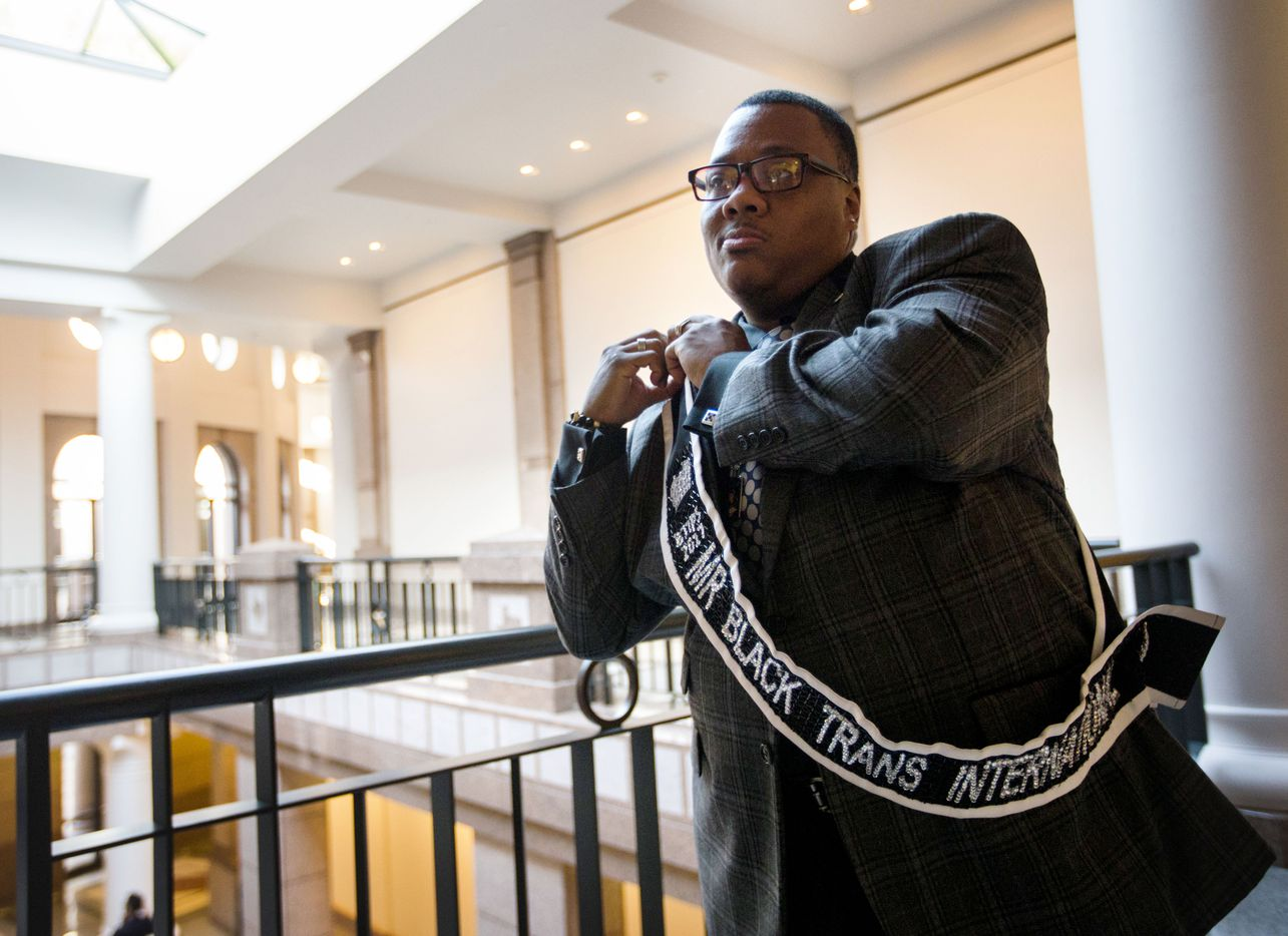 Trenton Johnson puts on his Mr. Black Trans International sash before entering a hearing room to voice his opposition to the bathroom bill at a Senate State Affairs Committee public hearing on the fourth day of a special legislative session on Friday, July 21, 2017 at the Texas state capitol in Austin, Texas.