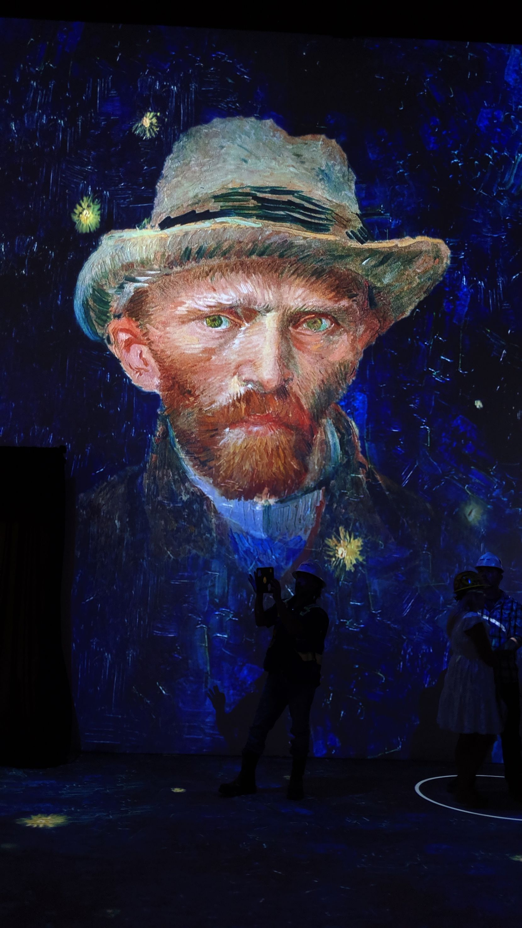 """One section of """"Immersive Van Gogh Exhibit"""" projects a series of self-portraits by the Dutch painter."""
