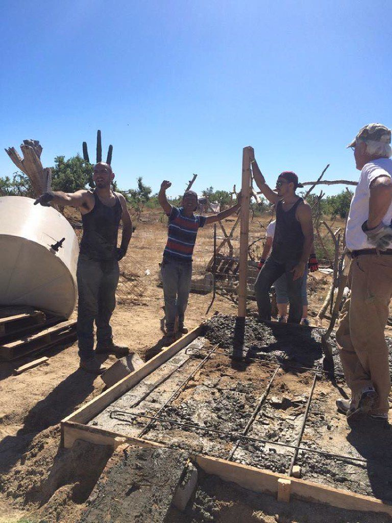 Elijah Hernandez (left) and Benjamin Hernandez (second from right) work in a barrio near Cabo San Lucas, Mexico, while on a religious mission trip in November 2014. Benjamin flew home to Dallas after seven days, leaving Elijah behind. He vanished in January 2015. (Courtesy of Teresa Hernandez)