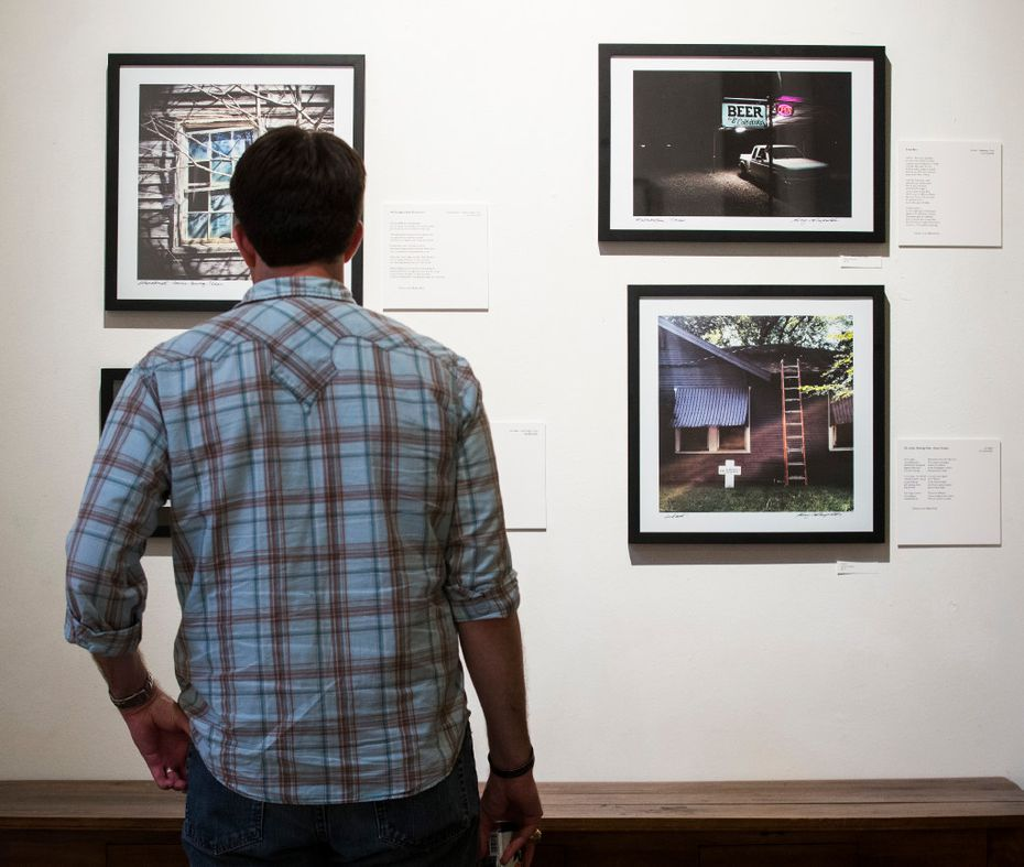 A man looks at photographs by Dallas Morning News photo editor Guy Reynolds at Kettle Art Gallery in Dallas.