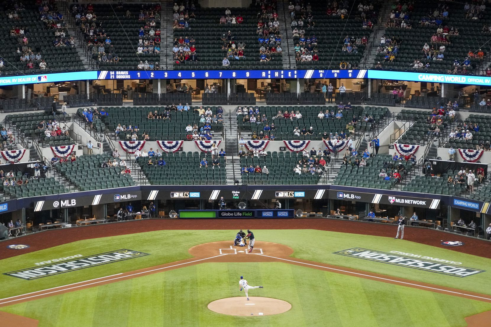 Los Angeles Dodgers starting pitcher Walker Buehler delivers the first pitch of the game to Atlanta Braves center fielder Ronald Acuna Jr. during first inning in Game 1 of a National League Championship Series at Globe Life Field on Monday, Oct. 12, 2020. (Smiley N. Pool/The Dallas Morning News)