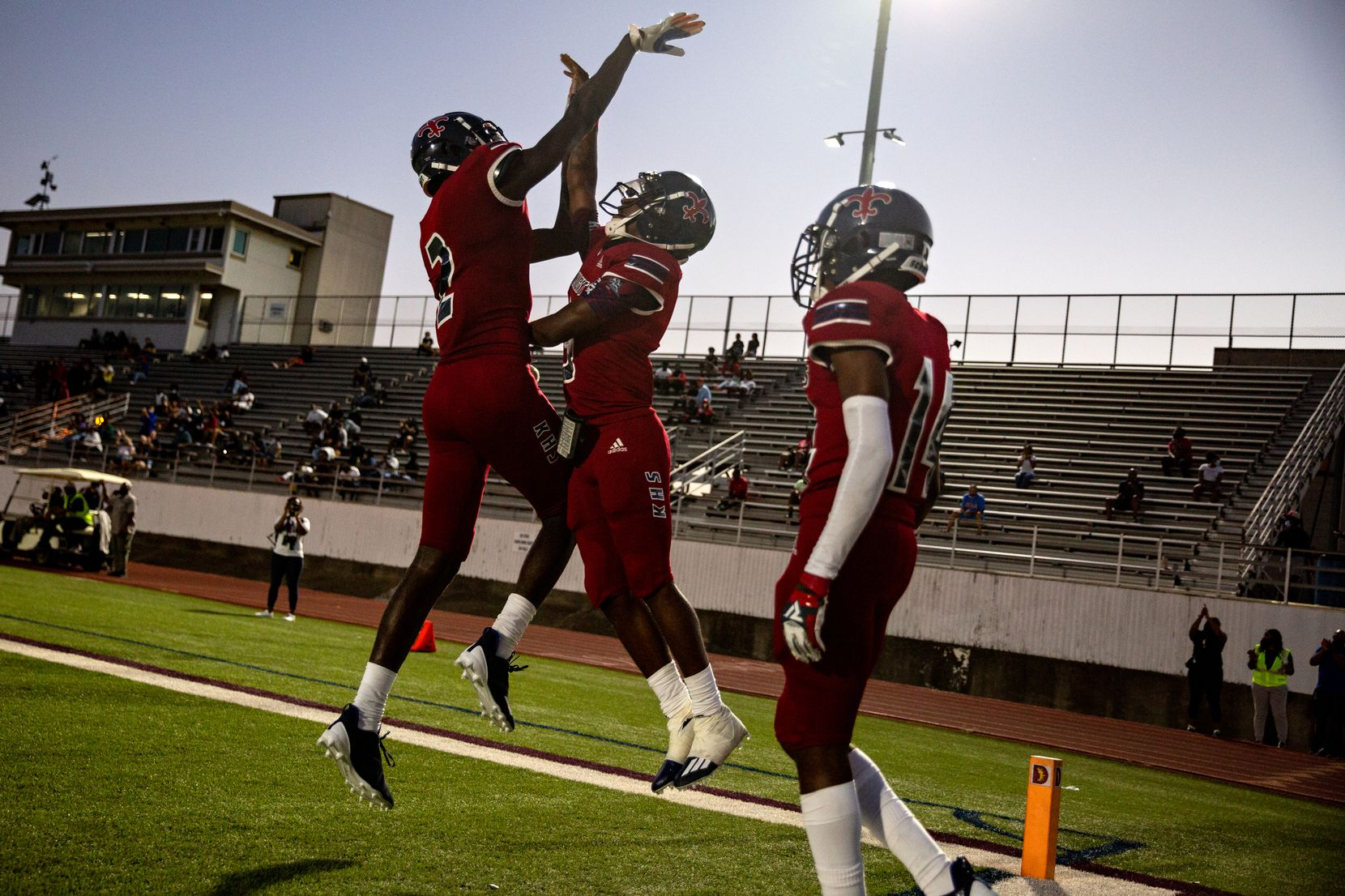 Justin F. Kimball High School players celebrate after a touchdown during their season-opening game against Garland High School at Sprague Stadium in Dallas, TX on August 27, 2021.   (Shelby Tauber/Special Contributor)